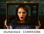 shocking news. woman journalist ...   Shutterstock . vector #1148442386