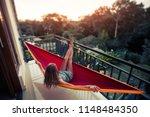woman relaxes in the hammock... | Shutterstock . vector #1148484350