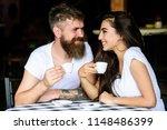 pleasant coffee break. couple... | Shutterstock . vector #1148486399