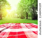 red and white empty blanket on... | Shutterstock . vector #1148494109