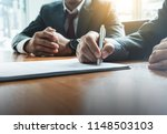 business man sign a contract... | Shutterstock . vector #1148503103