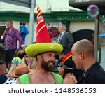 Small photo of Hastings,East Sussex/UK 08-02-18 Hastings pram race 2018. One of Hastings most entertaining and colourful events. Here 2 gentlemen have laugh and a chat before the race.