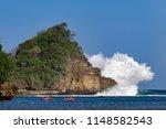 people paddling on kayak in... | Shutterstock . vector #1148582543