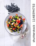 black linguine pasta with... | Shutterstock . vector #1148594753