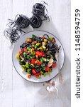 black linguine pasta with... | Shutterstock . vector #1148594759
