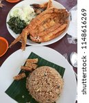 delicious nasi ayam penyet with ... | Shutterstock . vector #1148616269