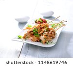 barbecued chicken skewers with... | Shutterstock . vector #1148619746
