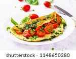 omelette with tomatoes  spinach ... | Shutterstock . vector #1148650280