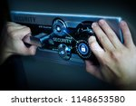 man hand open safe with cyber... | Shutterstock . vector #1148653580