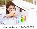 young female scientist student... | Shutterstock . vector #1148653676