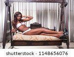pretty ebony model sitting on a ... | Shutterstock . vector #1148656076