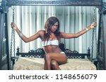 pretty ebony model sitting on a ... | Shutterstock . vector #1148656079