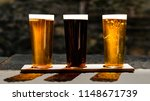 three beers in the sun. a... | Shutterstock . vector #1148671739