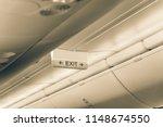 vintage tone emergency exit... | Shutterstock . vector #1148674550