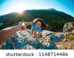 a smiling woman is climbing a... | Shutterstock . vector #1148714486