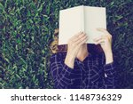 closeup of young woman reading... | Shutterstock . vector #1148736329