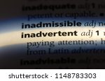 Small photo of inadvertent word in a dictionary. inadvertent concept.