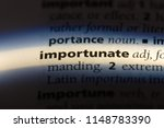 Small photo of importunate word in a dictionary. importunate concept.
