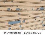 stainless rolling shutter door... | Shutterstock . vector #1148855729