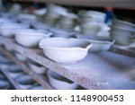 ceramic dishes in working... | Shutterstock . vector #1148900453