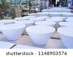ceramic dishes in working... | Shutterstock . vector #1148903576