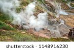 the steam from geysers. valley... | Shutterstock . vector #1148916230