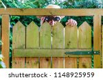 a curious neighbor stands... | Shutterstock . vector #1148925959