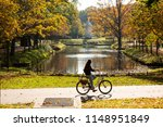 a female cyclist rides a... | Shutterstock . vector #1148951849