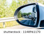 traffic jam in rear mirror.... | Shutterstock . vector #1148961170