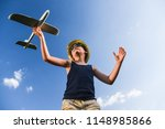 teenager playing with a plane | Shutterstock . vector #1148985866