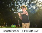 teenager playing with a plane | Shutterstock . vector #1148985869