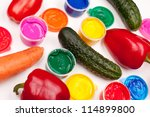 motley paints and vegetables (tomatos, cucumbers, sweet peppers, carrot) on the white background. studio shot - stock photo