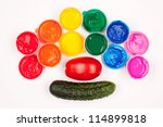 motley paints on the white background. paints arranged as rainbow with tomato and cucumber. studio shot - stock photo