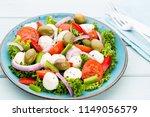 fresh vegetable salad. caprese. ... | Shutterstock . vector #1149056579