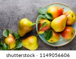 fresh bio pear with leaves on... | Shutterstock . vector #1149056606