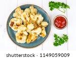 cauliflower fried in batter....   Shutterstock . vector #1149059009