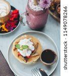 vegan pancakes served with... | Shutterstock . vector #1149078266