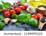 ripe tomatoes with fresh basil  ... | Shutterstock . vector #1149095210