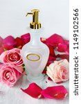 a bottle of perfume with red... | Shutterstock . vector #1149102566