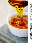 refined golden sugar syrup in... | Shutterstock . vector #1149137966