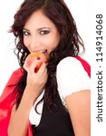 Little Red Riding Hood eating an apple - stock photo
