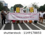 Small photo of Activists hold poster during a rally to protest against Assam National Register of Citizen or NRC final draft on August 4, 2018 in Calcutta, India.