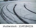 burnt rubber traces on asphalt   Shutterstock . vector #1149184226