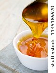 refined golden sugar syrup in... | Shutterstock . vector #1149186620