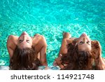 Two Young Women Relax And Take...