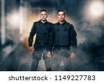 Cops in black uniform and body...