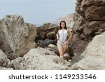 rocky seashore with smiling... | Shutterstock . vector #1149233546