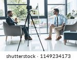 filming interview. two young... | Shutterstock . vector #1149234173