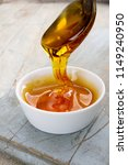 refined golden sugar syrup in... | Shutterstock . vector #1149240950