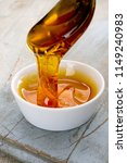 refined golden sugar syrup in... | Shutterstock . vector #1149240983